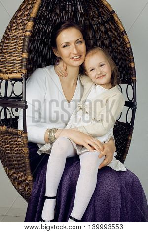 young mother with daughter at luxury home interior vintage, old fashion relashionship family