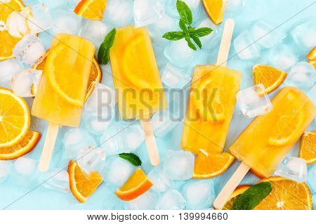 Fruit Homemade Popsicle With Slices Of Orange And Ice Cubes