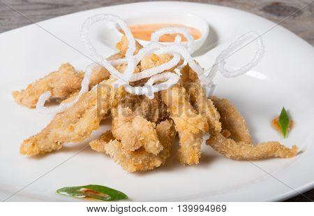 Fried pork meat in tempura asian style