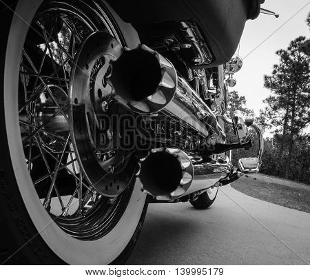 Motorcycle Dual Chrome Exhaust Pipes And Whitewall Tires
