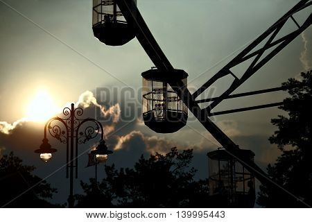 part of ferris wheel against the evening sky