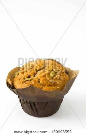 Muffin with nuts isolated on white background