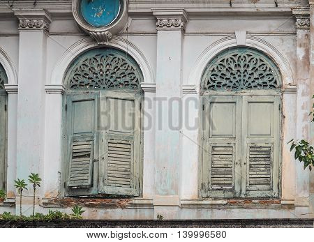 Old blue wooden windows at ancient building Bangkok, Thailand