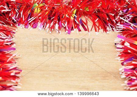 Red Christmas tree tinsel making a border