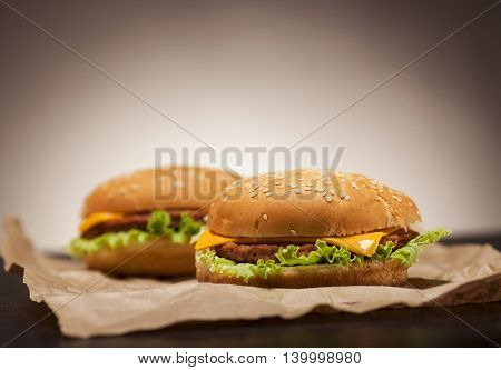 Fresh Burgers On Brown Background