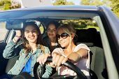 summer vacation, holidays, travel, road trip and people concept - happy teenage girls or young women poster