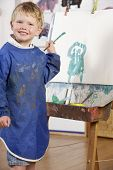 stock photo of montessori school  - Young Boy Painting - JPG