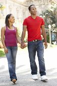Young Couple Walking Through City Street