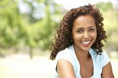 foto of middle-age  - Portrait Of Young Woman In Park - JPG