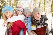 stock photo of family fun  - Family Having Fun Snowy Woodland - JPG