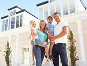 image of dream home  - Young Family Standing Outside Dream Home - JPG