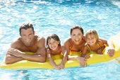 foto of swimming pool family  - Young family - JPG