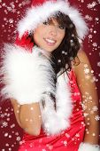 stock photo of santa claus hat  - Portrait of beautiful sexy girl wearing santa claus clothes on red background - JPG