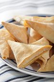 foto of phyllo dough  - Phyllo triangles with cottage cheese on the plate - JPG