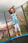 image of bounce house  - Small cute child jumping on trampoline  - JPG