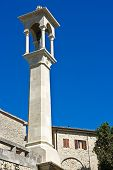 Obelisk with a sculpture of the sacred. San Marino.
