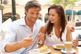 stock photo of hot couple  - Young Couple Enjoying Coffee And Cake In Cafe - JPG