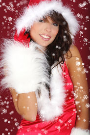 picture of santa claus hat  - Portrait of beautiful sexy girl wearing santa claus clothes on red background - JPG