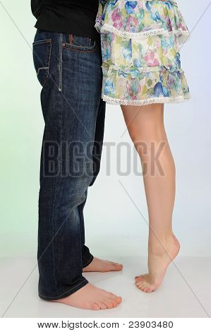 Legs Of Beautiful Couple Kissing. Studio Shot