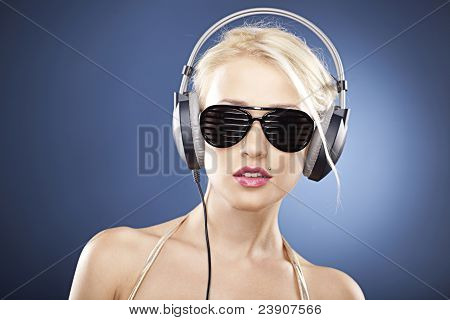 Portrait Of A Beautiful Model With Headphones And Sunglasses