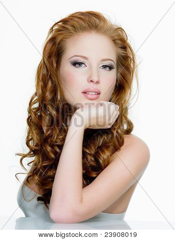 Beautiful Red-haired Woman With Long  Wavy Hairs