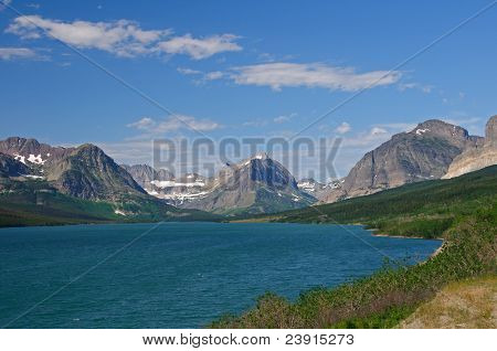 Alpine Mountains And Lake