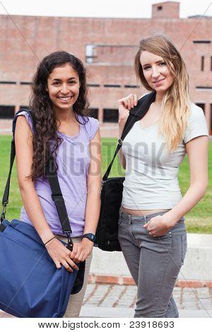 Portrait of friends posing outside a building
