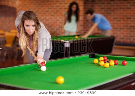 Woman playing snooker in a student home