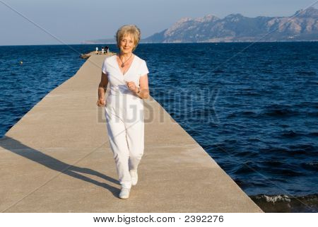 Fit Healthy Active Senior Woman Jogging