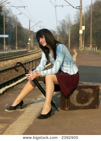 Young Girl Waiting For The Train