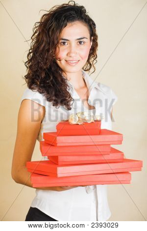 Happy Businesswoman With Red Gifts