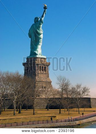 Back view of Statue of Liberty next to