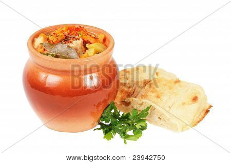 Roast in a pot and pita bread