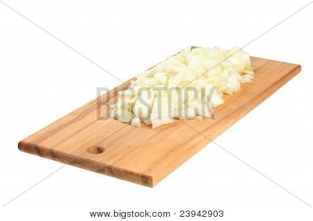 Chopped onions on a wooden board