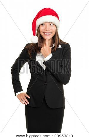 christmas business woman thinking looking to the side wearing santa hat and business suit. Multi-racial santa businesswoman isolated on white background.