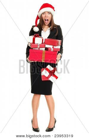 Stress christmas shopping business woman holding many gifts busy for holidays. Full length isolated on white young asian caucasian businesswoman.
