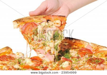 Pizza and slice of pizza in hand