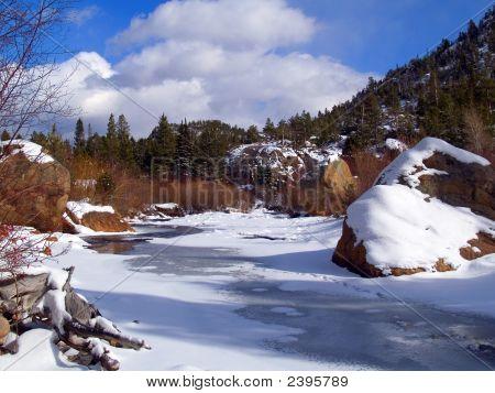Freezing River And Blue Sky