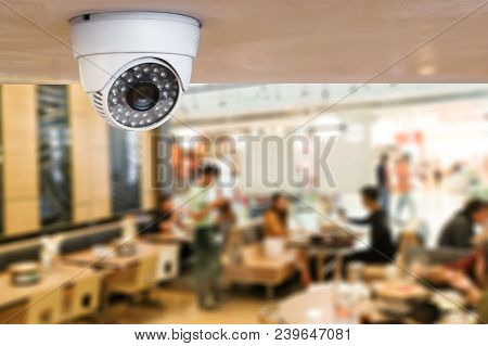 poster of Cctv System Security Inside Of Restaurant.surveillance Camera Installed On Ceiling To Monitor For Pr