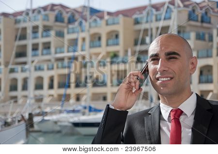 Business Man On The Phone At The Marina