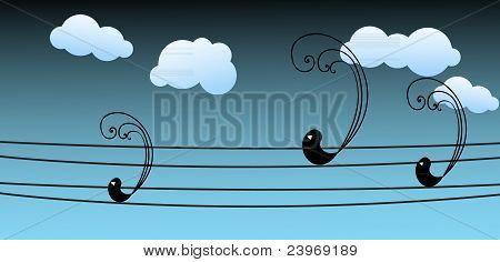 Black birds sitting on the wires at night