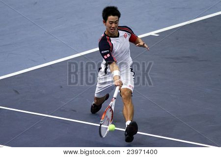 BUKIT JALIL, MALAYSIA- OCT 01:: Japan's Kei Nishikori hits a forehand return in this Malaysian Open semifinal match against Serbia's Janko Tipsarevic on October 01, 2011 in Putra Stadium, Bukit Jalil, Malaysia.