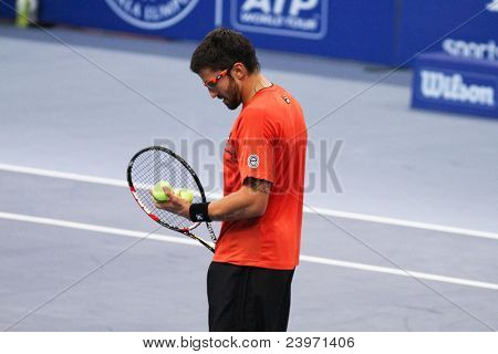 BUKIT JALIL, MALAYSIA- OCT 01: Serbia's Janko Tipsarevic prepares to serve in this Malaysian Open semi-final match against Japan's Kei Nishikori on October 01, 2011 in Putra Stadium, Bukit Jalil, Malaysia.