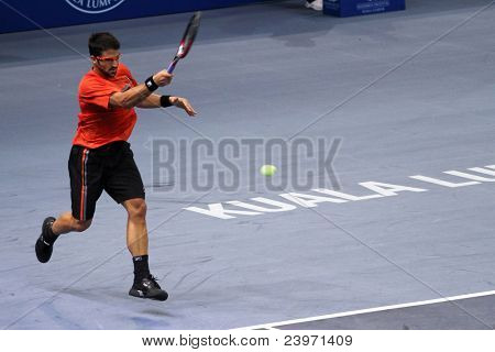 BUKIT JALIL, MALAYSIA- OCT 01: Serbia's Janko Tipsarevic hits a forehand return in this Malaysian Open semi-final win over Japan's Kei Nishikori on October 01, 2011 in Putra Stadium, Bukit Jalil, Malaysia.