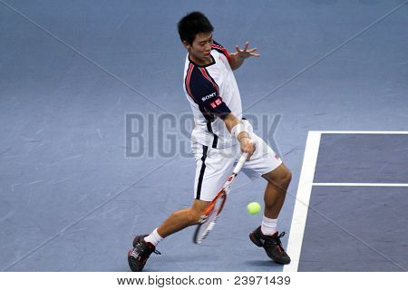 BUKIT JALIL, MALAYSIA- OCT 01: Japan's Kei Nishikori hits a return in this Malaysian Open semi-final match against Serbia's Janko Tipsarevic on October 01, 2011 in Putra Stadium, Bukit Jalil, Malaysia.