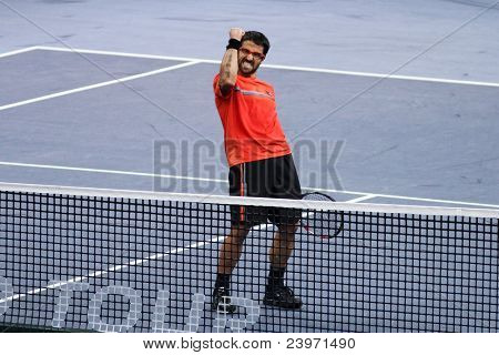 BUKIT JALIL, MALAYSIA- OCT 01: Serbia's Janko Tipsarevic reacts after his Malaysian Open semi-final win over Japan's Kei Nishikori by 6-4, 6-3 on October 01, 2011 in Putra Stadium, Bukit Jalil, Malaysia.