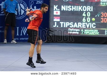 BUKIT JALIL, MALAYSIA- OCT 01: Serbia's Janko Tipsarevic hits a backhand return in this Malaysian Open semi-final win over Japan's Kei Nishikori on October 01, 2011 in Putra Stadium, Bukit Jalil, Malaysia.