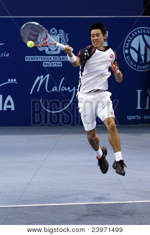 BUKIT JALIL, MALAYSIA- OCT 01: Japan's Kei Nishikori hits a forehand return in this Malaysian Open semifinal match against Serbia's Janko Tipsarevic on October 01, 2011 in Putra Stadium, Bukit Jalil, Malaysia.