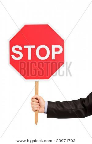 A hand holding a traffic sign stop isolated against white background