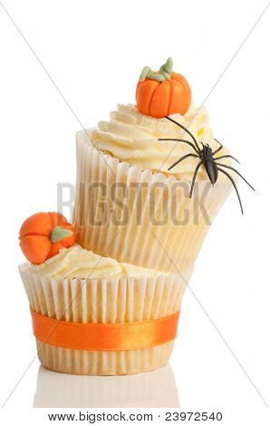 Homemade Halloween pumpkin cupcakes on white background for trick or treat night